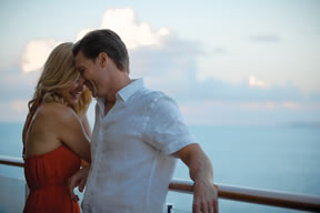 Couple on balcony of a cruise