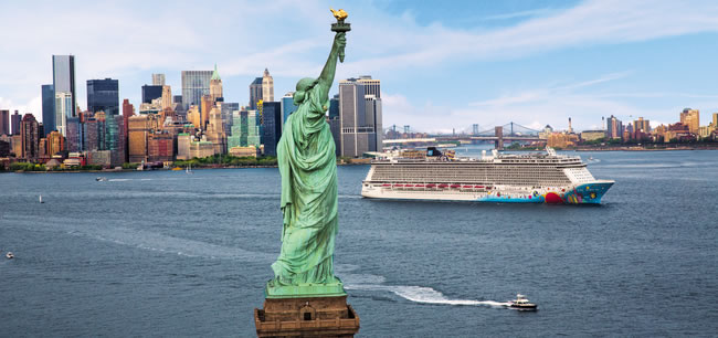 Cruise Ship sailing past the statue of liberty