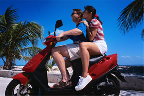 Couple on a motor scooter in Bermuda